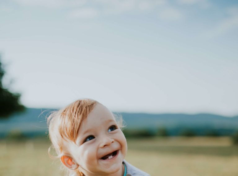 Smiling toddler with baby teeth